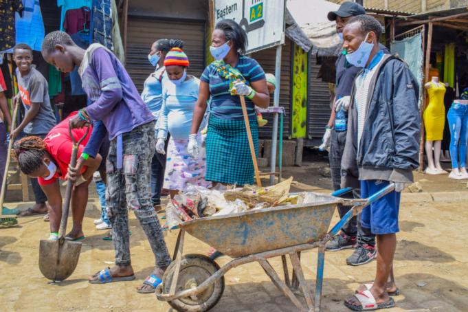 Community members in Kariobangi collect trash in their neighborhood